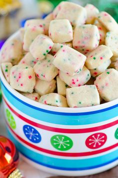 Jingle Bell Bites (Holiday Shortbread Bites) Holiday Bites 1/2 cup unsalted butter, at room temperature (plus more to butter the pan) 1/4 cup granulated sugar 1/4 teaspoon almond or vanilla extract 1 1/4 cups all-purpose flour 1/4 teaspoon salt 4 teaspoons Christmas colored nonpareils