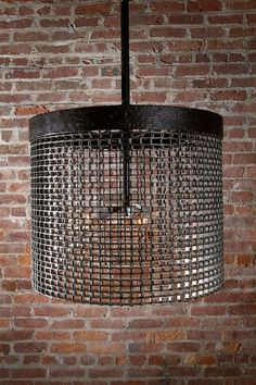 A factory wheel and conveyor belt reclaimed and repurposed as an outstanding industrial chandelier.