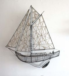 129.95-Metal and Jute Sailboat Sculpture 39W X 6.50D X 43