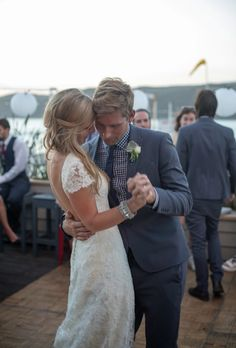 Cute pic and love what the groom is wearing