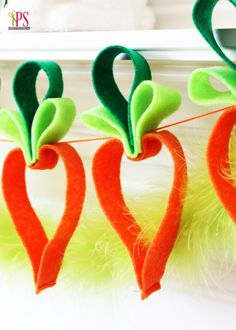 Easy Felt Carrot Garland (Easter Craft Idea).  I think this could be done with construction paper, too!