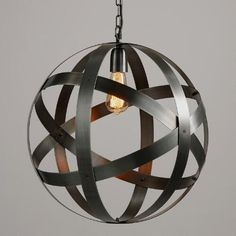 Crafted of galvanized metal with an antique zinc finish and a brushed texture, our exclusive open orb pendant adds a touch of industrial-chic style. Pair it with one of our vintage-style filament bulbs to illuminate it with a warm glow.