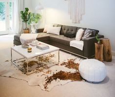 I like the cowhide under the little coffee table...unexpected somehow.