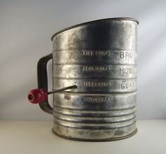 Flour Sifter - my mother was trying to make 75 gingerbread men for a party at noon when my sister poured water into the flour sifter - just another minor disaster back in the '50's