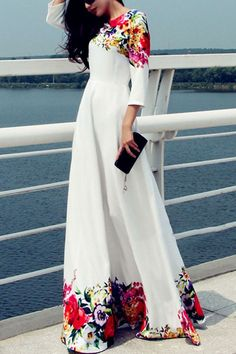 We are lusting over this fanciful floral maxi dress. With round neckline this white number with multi color floral print detail is totally chic with 3 quarter sleeve feature. Team with tan sandals and tassel bag for a dreamy finish.