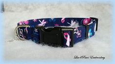 Paws for the Cause...Breast Cancer Awareness adjustable collar in Navy Blue prewashed quality cotton fabric with scattered Pink ribbons and colorful Butterflies. It is made with heavy weight interfacing and a strong nylon acetate buckle. A small Paw or Bone collar charm is included. by Luv4PawsEmbroidery