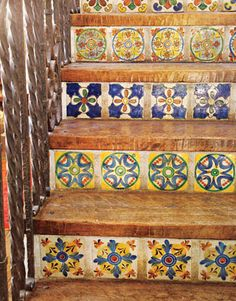 Talavera tiles line the stair risers leading to the former hayloft, now a media room.