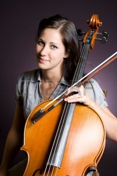 Portrait of a gorgeous young classical musician woman with her cello. Stock Photo - 15229695