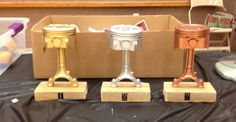 PINEWOOD DERBY TROPHIES! My hubby made these awesome trophies for Pinewood Derby out of Pistons and Connector Rods. Pretty creative if you ask me!  Nicely done @jaysgarage