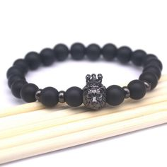"Onyx Stone Bracelet ""King"" – 13.35$    Crafted with one 18kt gold plated Lion and 8mm matte onyx beads.  Crafted with 0.8 mm elastic cord.  Size 6""-7"" (17-19 cm)  Colors: Gold , Rose Gold , Silver ,Black"