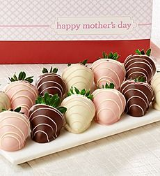 Show Mom how much you love her this Mother's Day. Fannie May strawberries are dipped in delicious 100% Real Milk, Dark & White Chocolate. Big, delicious and decadent, Fannie May Chocolate Covered Stemmed Strawberries are pure bliss. Treat the special woman in your life by giving a one-of-a-kind gourmet gift, these strawberries are sure to please. Our 12 gourmet strawberries include 4 each of the following taste sensations: pink champagne, milk chocolate with white chocolate drizzle, white…