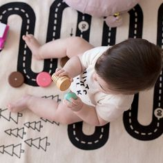 Gorgeous munchkin playing on our gorgeous Adventure Rug  Check out that stunning head of hair  Styling by @yougivemegrace and photography by @jokimphotography x  w w w . m i l k t o o t h . c o m . a u