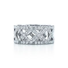 Braided band ring with diamonds in platinum.
