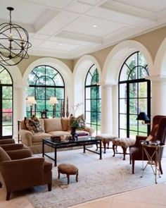 I think Mom should paint all her arched sunroom windows black just like this!