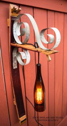 Wine bottle sconce on wine barrel stave {wineglasswriter.com/}