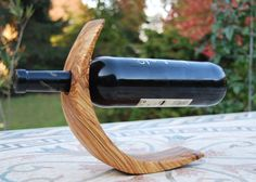 Olive wood bottle holder wine stand