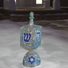 Display this spinning dreidel in your yard in the spirit of the season. With 70 miniature lights and tinsel accents, it is sure to be an eye-catching tribute to the Chanukah tradition.