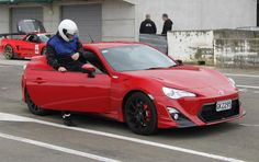 A beautiful red TRD toyota 86 getting ready for some track action.. drift away!
