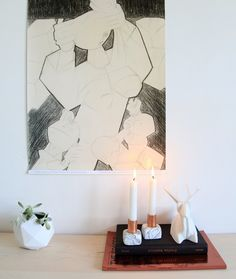 Use oven bake clay and copper piping to create marbled candleholders.