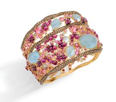 Bracelet in 18k yellow gold with round brown diamonds, aquamarine, ruby, and pink tourmaline.