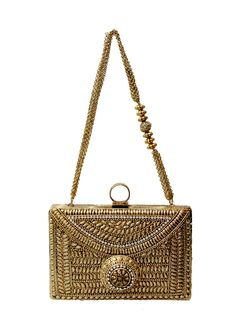 This spectacular antique gold clutch by Meera Mahadevia features golden accents that make it perfect to be carried along for festive occasions. The clutch is in rectangular shape with intricate designs making it traditional and elegant. The most visually arresting aspect of the clutch is the gold and white beaded round broach in the centre. It comes with beaded chain sling.