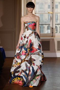 Schiaparelli Spring 2017 Couture Collection Photos- Vogue.A Fresh Vision Of Lovilness That Evokes The Call To Spring With Explosive Pops Of Colour In The Form Of Lush,Bold,Abstract Blooms.Strapless,Set In Waist Bodice Is Also Perfect For Those Balmy,Warm,Sultry Nights.Top With A Light Wrap,Shawl,Or Pashmina,And You're Good To Go!