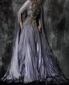 Purple flowy gown with detailed bodice.