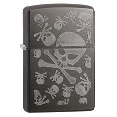 Iced Skulls. Iced AE Under Translucent with a Grey Dusk Flint Ignition and a Windproof Flame. Features a Signature Zippo Click and Comes Packaged in Black Zippo Branded Box. Material: Metal Occasion:
