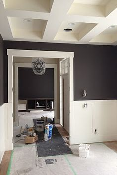 white molding, black walls, love this. Would look great with dark purple as well love the ceiling detail White Wainscoting, Home, Black Rooms, Veranda Interiors, White Paneling, Dining Room Paint, Black Walls, White Molding, Black Bathroom