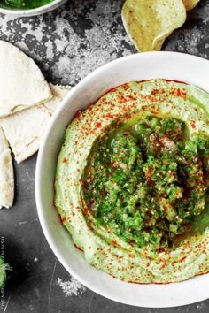 Avocado Hummus with Fresh Tomattillo Salsa Verde from The Mediterranean Dish! Super creamy avocado hummus dip topped with flavor packed fresh tomattillo salsa verde. Two amazing appetizer recipes combined! Great for game day or any party! #ComfortFoodFeas