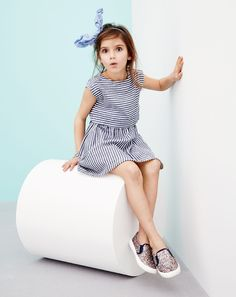 J.Crew girls' two-in-one dress in stripe, bow headband in sunwashed cobalt, and glitter slip-on sneakers.