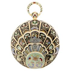 Breguet Pocketwatch C.1830 - France  18K gold Breguet jump hour enamel pocketwatch, the scalloped form entirely enameled in radiating champlevé enamel layers of Victorian motifs depicting acanthus leaves, poppies, peonies, chrysanthemums and feathers. Designed by Breguet