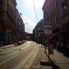 #wien #neubau #1070 #vienna #wienneubau #wien1070 #austria #siebensterngasse #streets #street #bim #tram #linie49 #wienerlinien #igersvienna #igersaustria #igersneubau #houses #architecture #sun #clouds #straßenbahn #schienen #7thdistrict Story Setting, Backdrops, Rose, Instagram, Train Tracks, New Construction, Pink, Backgrounds, Roses