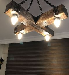 Inject a bit of life and personality into your home with modern ceiling light fixtures. Here's how to use ceiling lights in your home decor. Farmhouse Lighting, Rustic Lighting, Cool Lighting, Lighting Design, Rustic Farmhouse, Driftwood Chandelier, Outdoor Chandelier, Lustre Vintage, Wooden Lamp