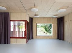 Image 9 of 22 from gallery of Double Pre-School Facility / Singer Baenziger Architects. Photograph by Christian Senti Early Childhood Centre, Kindergarten, Timber Slats, Christian School, School Building, Empty Room, School Architecture, Pre School, Cladding