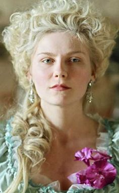 Kirsten Dunst in 'Marie Antoinette', 2006 Directed by Sofia Coppola & primarily filmed on location at the Palace of Versailles. The film was regarded by the French as upbeat, sensuous & iconoclastic - Sofia Coppola blended 21st Century Rock music with music & lyrics of the era creating a modern take on an enigmatic queen!