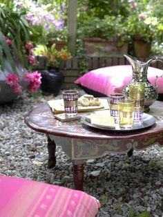 A relaxing Moroccan outdoor setting with tea and sweets. #Moroccan #Outdoor #Decor.