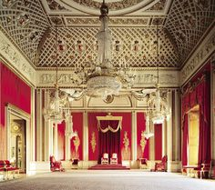 Throne Room, Buckingham Palace. This photogrpah also shows off Humphries Weaving broad loom Silk and cotton damask in two tones of crimson for wall covering and window drapes, and the hand cut silk velvet throne canopy hangings. www.humphriesweaving.co.uk