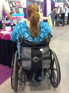 Look at how much storage space the Metro Silver Black Reptile adds to her chair! (2015 Boston Abilities Expo)