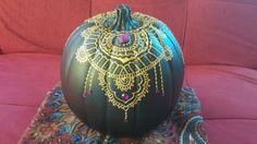 Black pumpkin with gold & purple #henna #pumpkin #pumpkindecorating #pumpkinpainting #halloween #falldecor #kidscraft #craftpumpkins http://www.halifaxhenna.com/henna-pumpkins.html