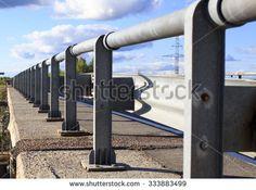 guardrail bridge. metal supports of the bridge enclosure closeup - stock photo
