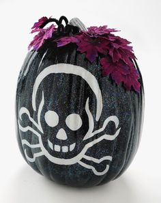 Decorate a faux pumpkin using a graphic, craft paint and Sparkle Mod Podge.