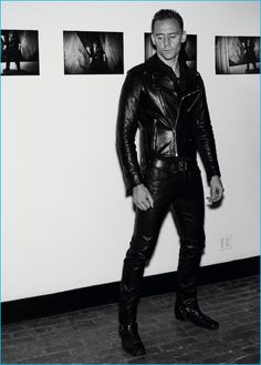 Tom Hiddleston channels his inner biker in a leather biker jacket and shirt from Coach. Photographed for Interview magazine, Hiddleston also wears J Brand leather pants with a Golden Goose Deluxe Brand belt and vintage boots.