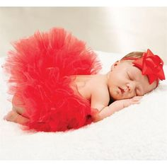 Baby's first Christmas has never been more adorable. This fluffy tiered tulle tutu makes the perfect photo prop for any newborn baby girl. It's even cuter than