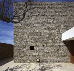 Architecture, Sleek Exposed Stone Wall Outside The Buenos Mares Villa With A Small Hole Beautify The Outside View With The Rustic Tree ~ Beach House Architecture with Private Pool