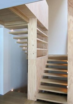 Natural wooden stairs in a house in the outskirts of Brussels by Samyn and Partners. Stairs And Doors, Green Facade, Wooden Stairs, Entry Hall, Dezeen, Inspired Homes, Sustainable Living, Stairways, My House