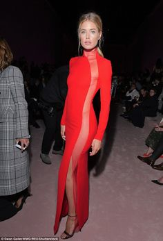 Eye catching: Model Doutzen Kroes looked incredible in a red turtleneck style dress, which featured a sheer panel from the neck to the hemline of the skirt at the Tom Ford show in New York on Wednesday