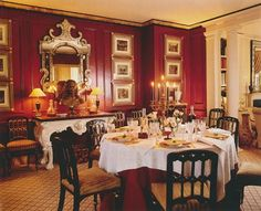 Mark Hampton: Mark Hampton's New York City dining room. Red walls, black and white furnishings and gold accents--stunning--11/24/12