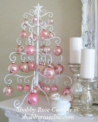 Pretty pink Christmas ornaments on a lovely white ironwork holiday tree. Pink Christmas Ornaments, Pink Christmas Decorations, Noel Christmas, All Things Christmas, White Christmas, Christmas Crafts, Christmas Mantles, Vintage Ornaments, Vintage Santas