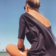 In the mood for some SUN  thank You beautiful @joanna_jarocka for this great pic! Shop our backless basics at theodderside.pl #simple #basic #love #fashion #ootd #outfit #lessismore #backless #tshirt #holiday #view #travel #girl #beauty